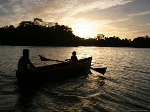 Two Children Sail in the Cocibolca Lake, Managua, Nicaragua by Esteban Felix