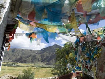 Prayer Flags and View Over Cultivated Fields, Yumbulagung Castle, Tibet, China
