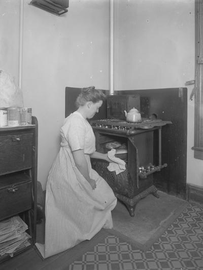Ethel Gray Magaw Hassler Taking Bread from the Oven, C.1913-William Davis Hassler-Photographic Print