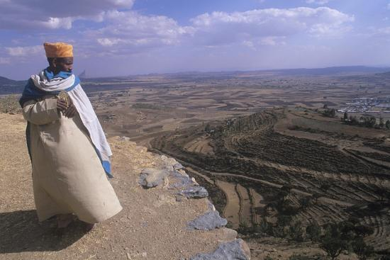 Ethiopia, Tigrai, Aksum, Monk Overlooking Monastery of Abba Pantelewon,  Founded in 6th Century Giclee Print by | Art com