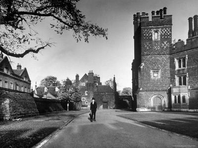 Eton Student in Traditional Tails and Topper Walking in Front of Weston Yard-Margaret Bourke-White-Photographic Print