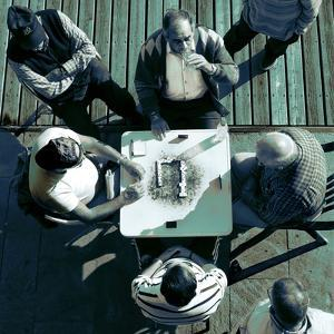 Looking Down at Men Playing Dominoes by Eudald Castells