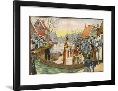 Saint Nicolas Arrives by Canal in a Dutch Village Accompanied by Black Peter