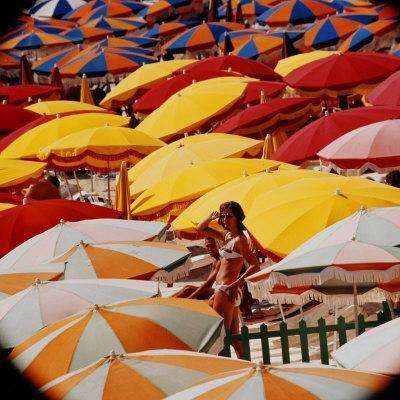 https://imgc.artprintimages.com/img/print/europe-beach-scene-crowded-with-colorful-umbrellas-and-a-bikini-clad-young-woman_u-l-p68vqp0.jpg?p=0