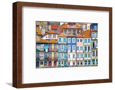 Europe, Portugal, Porto. Colorful building facades next to Douro River.-Jaynes Gallery-Framed Photographic Print