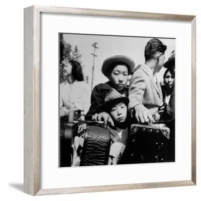 Evacuees of Japan Awaiting Turn for Baggage Inspection upon Arrival at Assembly Center During WWII-Dorothea Lange-Framed Photographic Print
