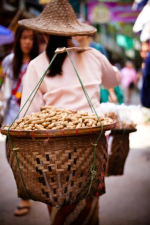 Woman Carrying Peanut Baskets - Golden Triangle, Thailand by EvanTravels