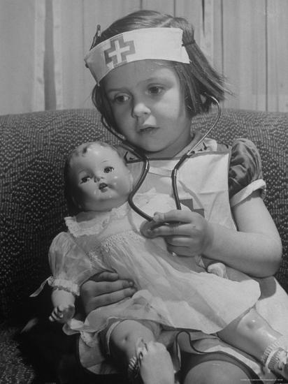 Evelyn Mott playing Nurse with doll as parents adjust children to abnormal conditions in wartime-Alfred Eisenstaedt-Photographic Print