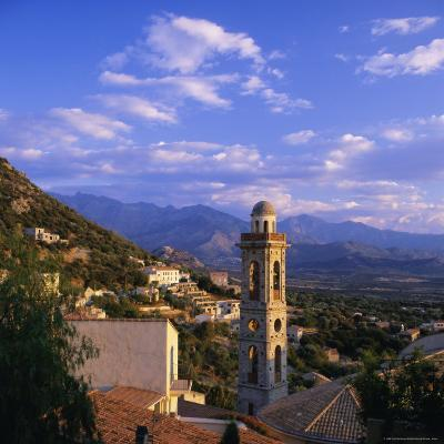 Evening View Across Rooftops and Church Tower to Mountains, Lumio, Near Calvi, Corsica, France-Ruth Tomlinson-Photographic Print