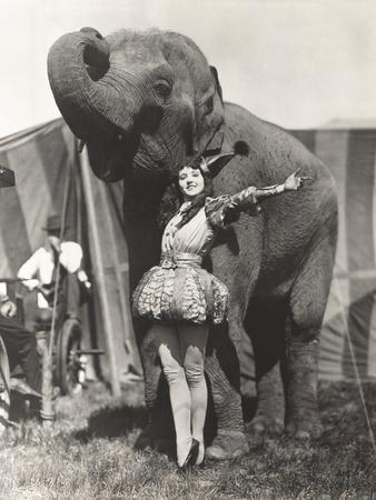 Circus Performer Posing with Elephant