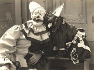 Clown Posing with Dog Dressed in Clown Costume by Everett Collection