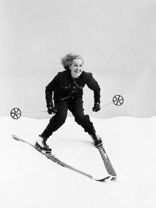 Female Skier Skiing Downhill by Everett Collection