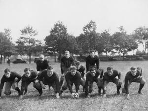 Football Team in Field by Everett Collection