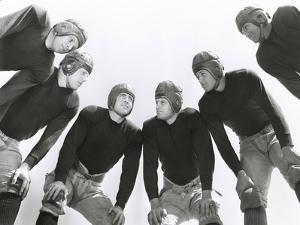 Low Angle View of Football Huddle by Everett Collection