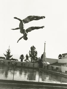 Synchronized Divers in Mid-Air by Everett Collection