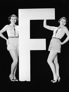 Twins with Huge Letter F by Everett Collection