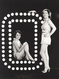 Two Models Posing by Large Letter O by Everett Collection