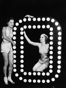 Two Young Women Posing with the Letter O by Everett Collection