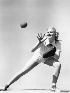 Woman Catching a Baseball by Everett Collection