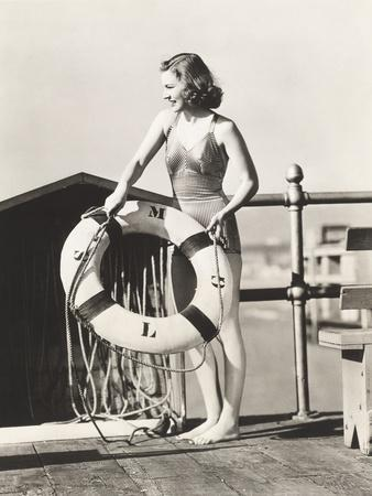 Woman on Pier Holding a Life Preserver
