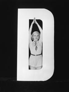 Woman Posing in Middle of Letter D by Everett Collection