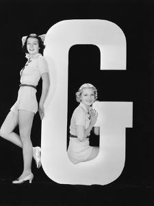 Women Posing with Huge Letter G by Everett Collection