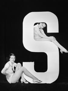 Women Posing with Huge Letter S by Everett Collection