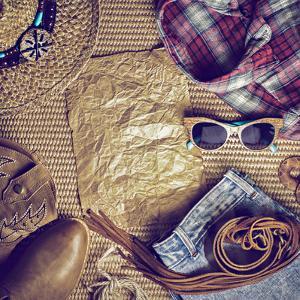 Accessories Cowboy Retro Style on Wooden Background with Blank Vintage Poster by Evgeniya Porechenskaya