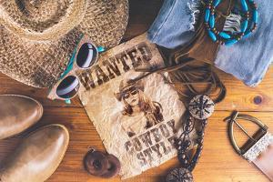 Accessories Cowboy Retro Style on Wooden Surface with Wanted Pos by Evgeniya Porechenskaya