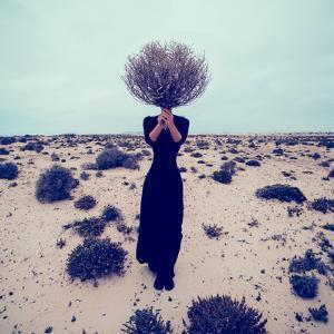 Fashion Photo. Girl in the Desert with a Bouquet Dead Branches by Evgeniya Porechenskaya