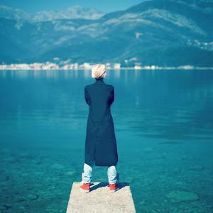 Fashion Portrait of a Stylish Girl on the Sea by Evgeniya Porechenskaya