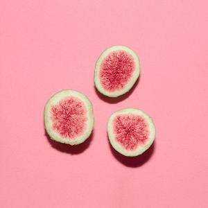 Fresh Figs on Pink Background.Vanilla Fashion Style by Evgeniya Porechenskaya
