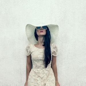 Sensual Vintage Girl at a Wall by Evgeniya Porechenskaya