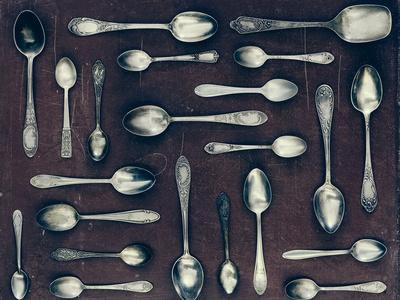 Vintage Set of Dessert Spoons on a Dark Background