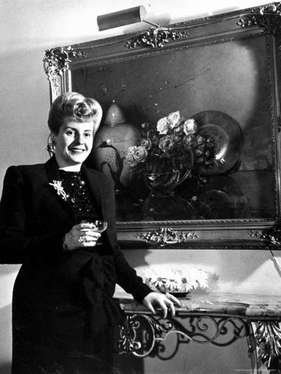 Evita Peron, Wife of Argentinean Presidential Candidate With. a Glass of Champagne in Her Apartment-Thomas D^ Mcavoy-Premium Photographic Print