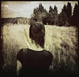 Woman Following Trail in Field by Ewa Zauscinska