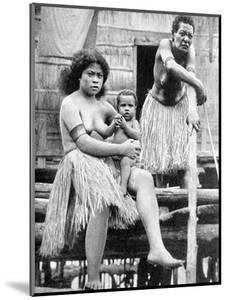 A Mother and Her Child, Papua, New Guinea, 1936 by Ewing Galloway