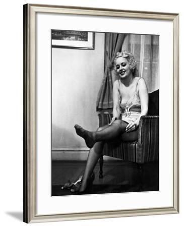 Ex-Burlesque Stripper June St. Clair Removing Stockings at the Allen Gilbert School of Undressing-Peter Stackpole-Framed Photographic Print