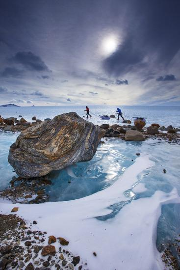 Expedition team members trek over blue glacial ice.-Cory Richards-Photographic Print