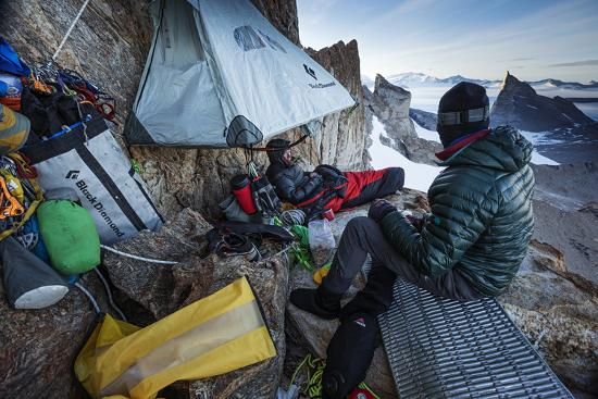 Expedition Team Members Try to Stay Warm on a Ledge of Bertha's Tower,1,200 Feet Above the Ground-Cory Richards-Photographic Print