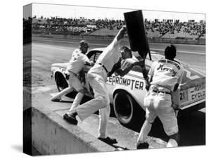 Expert Mechanics Making Repairs on a Car During the Daytona 500 Race