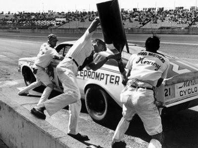 Expert Mechanics Making Repairs on a Car During the Daytona 500 Race