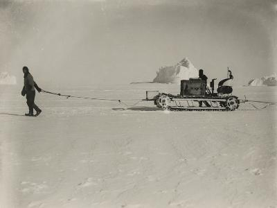 Explorers Guide a Motorized Sledge Hauling Supplies-Herbert Ponting-Photographic Print