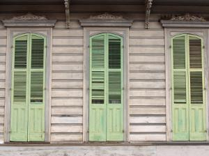 Exterior of Building with Green Window Shutters in New Orleans, Louisiana