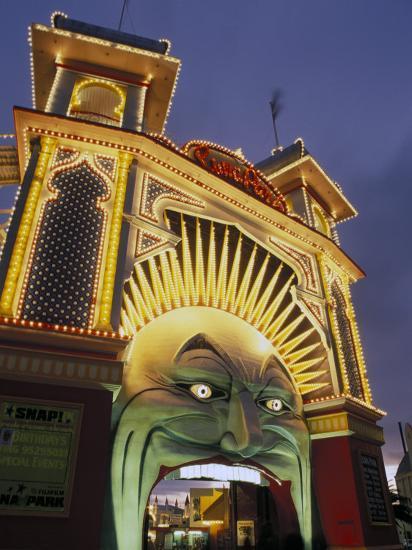 Exterior of Luna Park Entrance Illuminated at Twilight, St. Kilda, Melbourne, Victoria, Australia-Richard Nebesky-Photographic Print