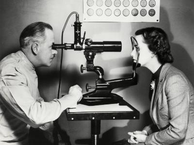Eye Doctor Examining Patient-George Marks-Photographic Print