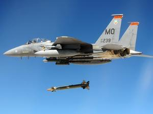 F-15 Strike Eagle Fighter Drops a Guided Bomb in Exercises, Ca. 1980s