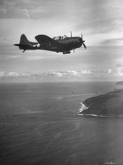 F-6 Hellcat Fighter Plane over Tanahmera Bay as Japanese Airfields at Hollandia, New Guinea-J^ R^ Eyerman-Photographic Print