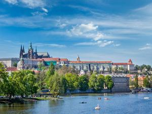 Panorama View of Vltava River and Gradchany (Prague Castle) and St. Vitus Cathedral and Charles Bri by f9photos