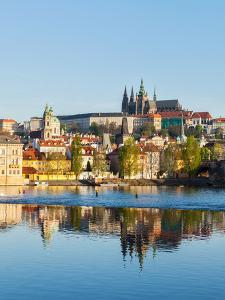View of Charles Bridge over Vltava River and Gradchany (Prague Castle) and St. Vitus Cathedral by f9photos